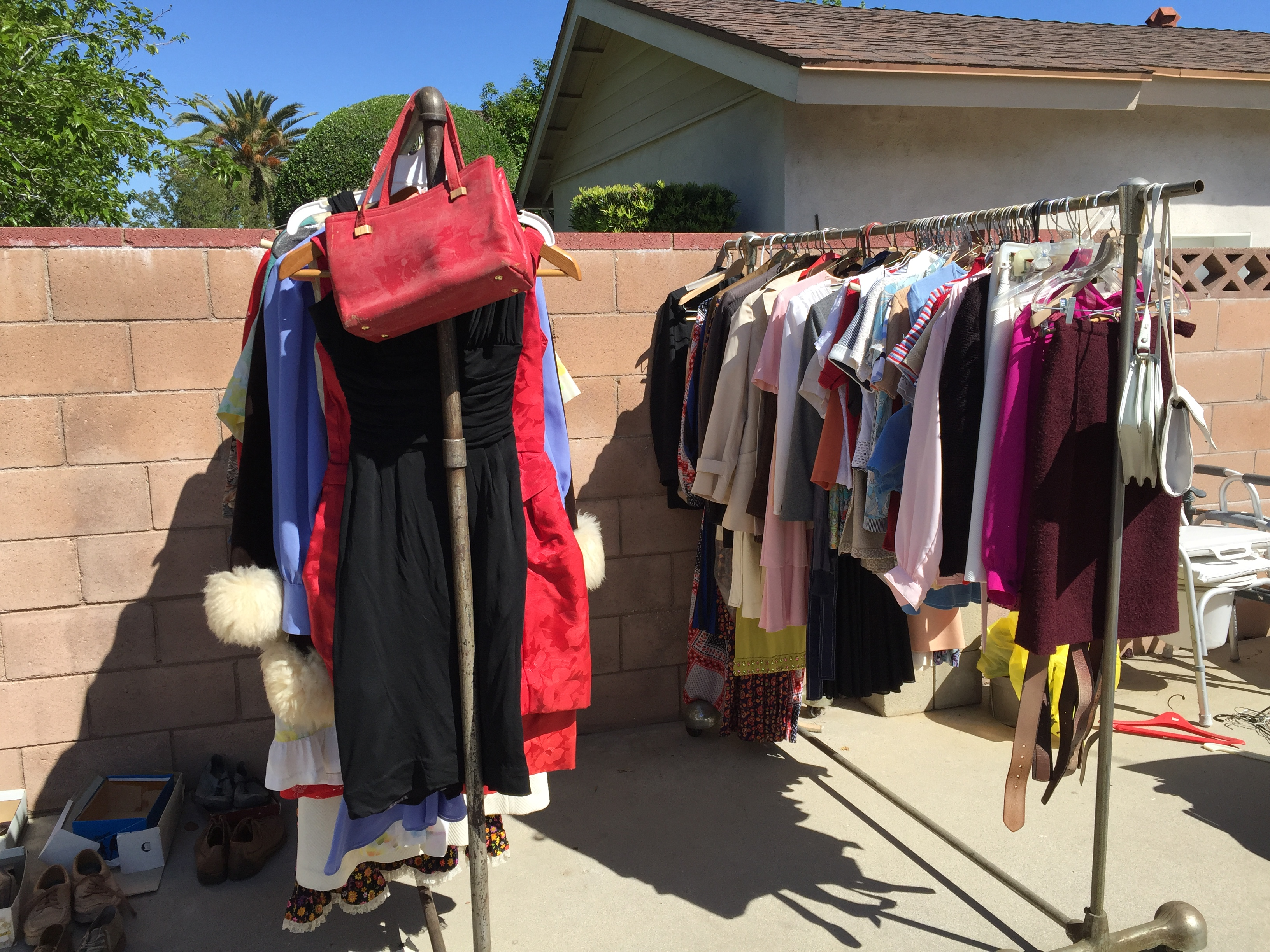 clothes racks at garage sale