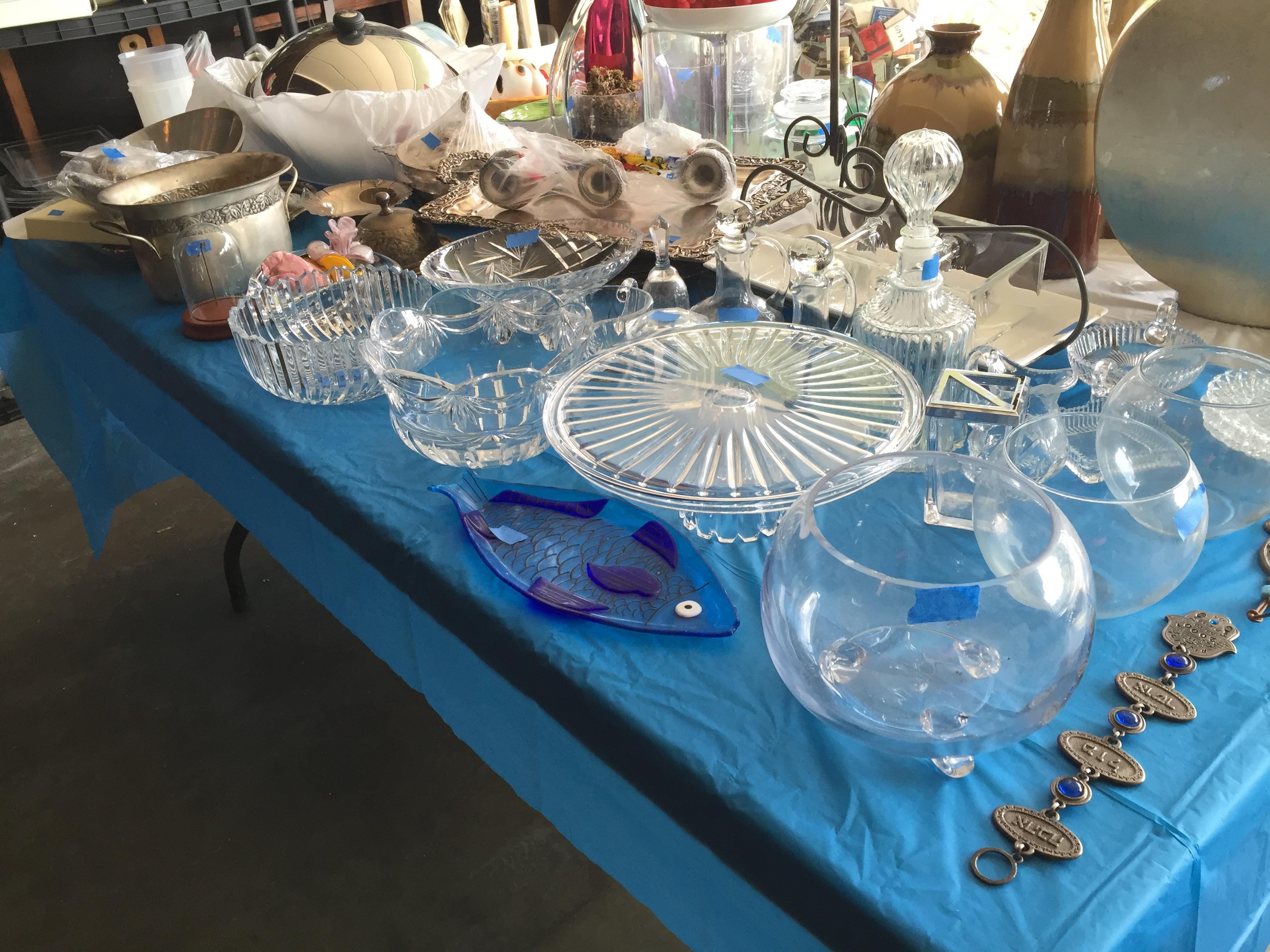 estate sale glassware display table
